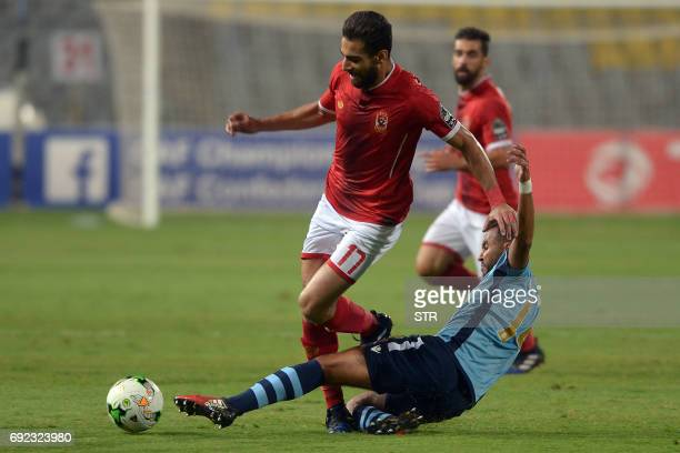Morocco Wydad Casablanca's player Lamrabat vies for the ball with Egypt's Al Ahly player Waled Soliman during the African Champions League group...
