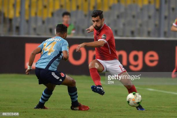 Morocco Wydad Casablanca's player Larabat vies for the ball with Egypt's Al Ahly player Abdalla ElSaid during the African Champions League group...