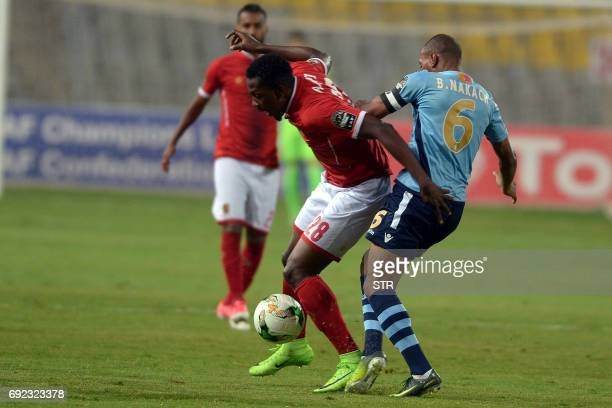 Morocco Wydad Casablanca's player Nakach vies for the ball with Egypt's Al Ahly player Ajayi during the African Champions League group stage football...