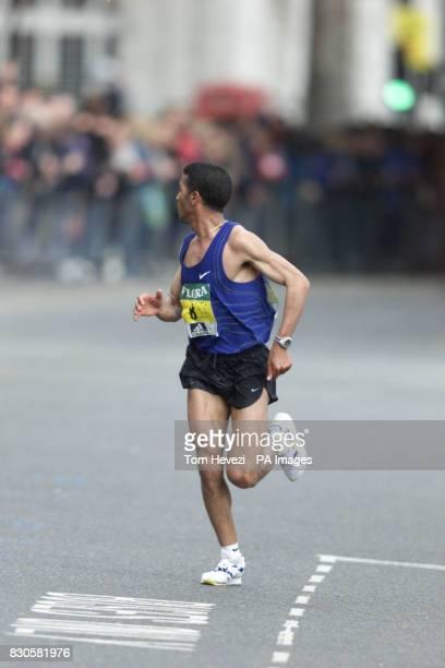 Morocco's Abdelkader El Mouaziz looks around for challengers on London's Embankment on his way to winning the London Marathon in convincing fashion...