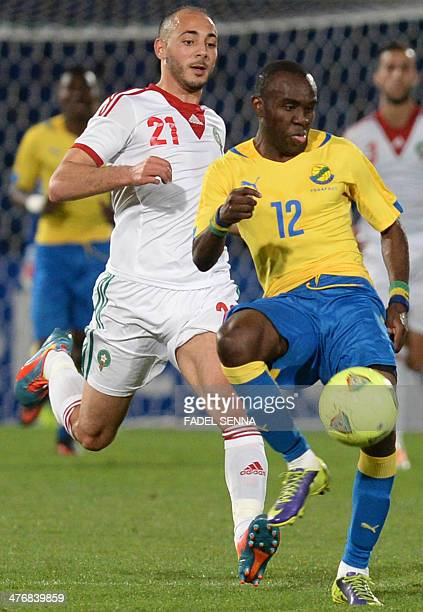 Morocco's Amrabet Noureddine fights for the ball with the Gabon's Abdoulay Tandjigora during an international friendly football match in Marrakech on...