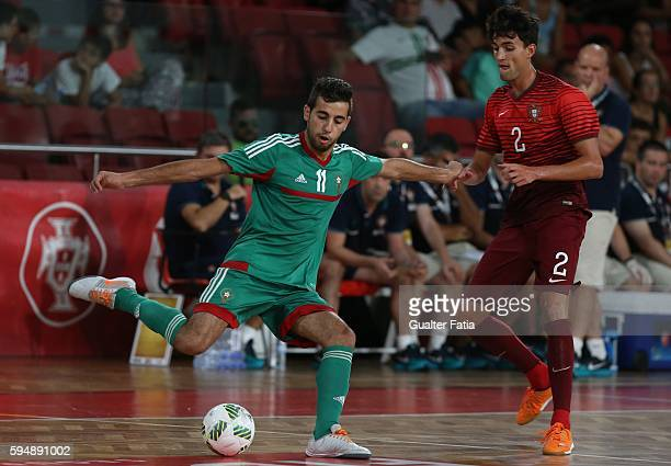 Morocco's Bilal Bakkali with Portugal's Andre Coelho in action during the Futsal International Friendly match between Portugal and Morocco at...