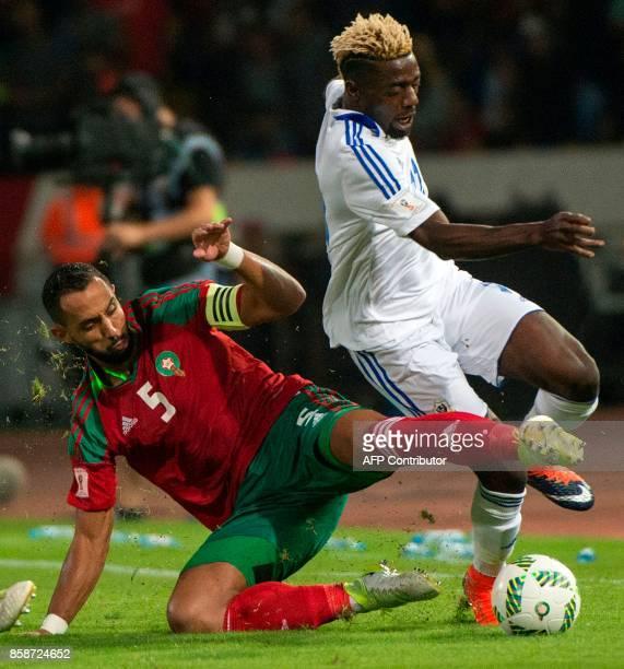 Morocco's captain and defender Medhi Benatia tackles Gabon's forward Axel Meye during their FIFA World Cup 2018 Group C football match between...