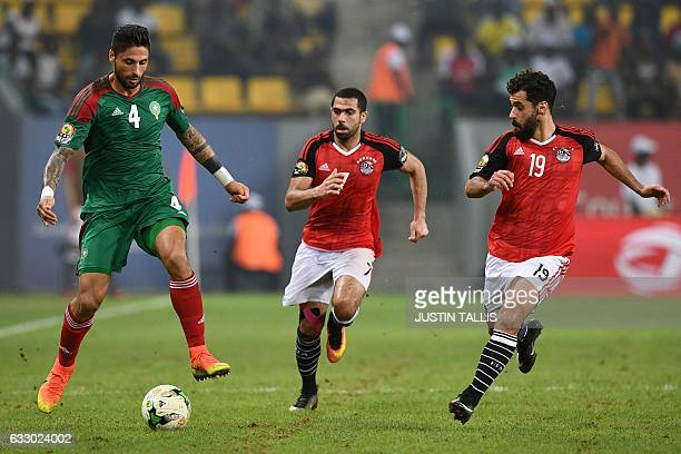 Morocco's defender Manuel Da Costa challenges Egypt's defender Ahmed Fathi and Egypt's forward Abdallah Said during the 2017 Africa Cup of Nations...