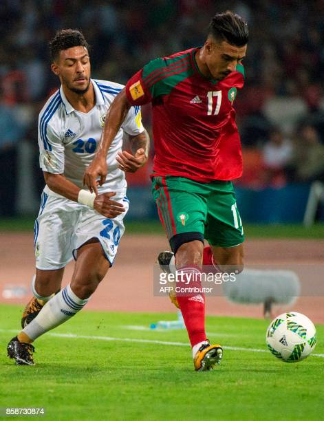 Morocco's defender Nabil Dirar vies for the ball with Gabon's midfielder Denis Bouanga during their FIFA World Cup 2018 Group C football match...