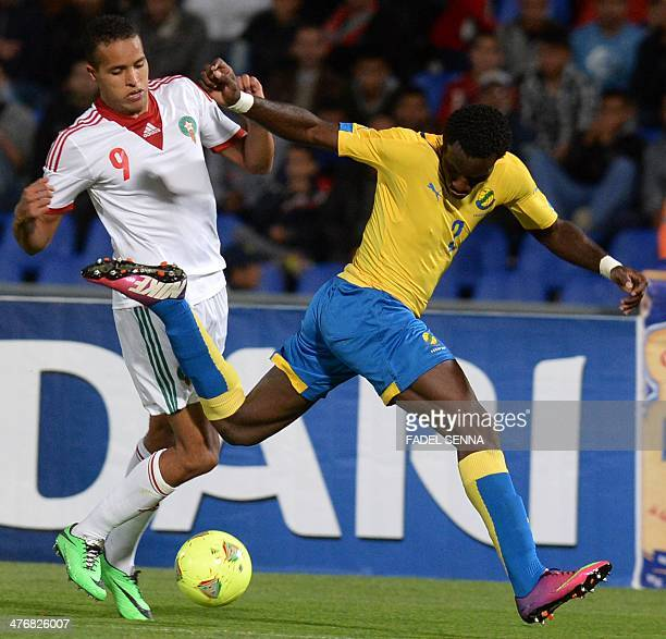 Morocco's El Arabi Yousef fights for the ball with Gabon's Andre Aaron Apindgoye during their 2014 World Cup international friendly football match in...
