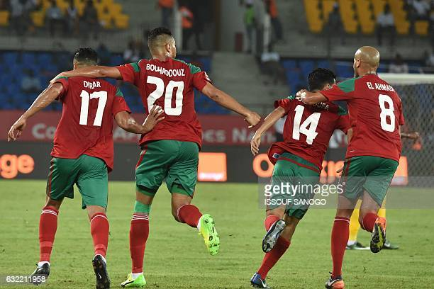 Morocco's forward Aziz Bouhaddouz celebrates with teammates after scoring a goal during the 2017 Africa Cup of Nations group C football match between...