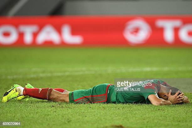 Morocco's forward Aziz Bouhaddouz reacts during the 2017 Africa Cup of Nations quarterfinal football match between Egypt and Morocco in PortGentil on...