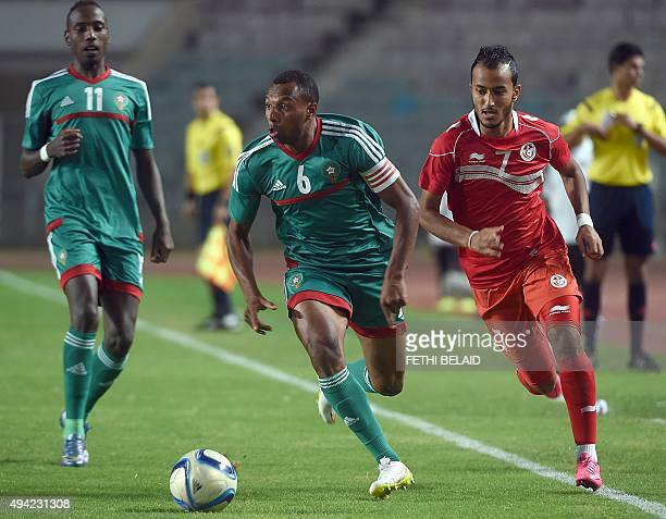 Morocco's forward Brahim Nakach vies for the ball with Tunisian forward Hamza Lahmar during an African Nations Championship qualifying match on...