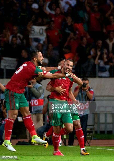 Morocco's forward Khalid Boutaib celebrates his goal with teammate Nabil Dirar and Medhi Benatia during their FIFA World Cup 2018 Group C football...