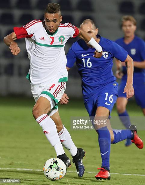 Morocco's forward Youssef EnNesyri advances with the ball past Finland's midfielder Sakari Mattila during a friendly football match between Morocco...