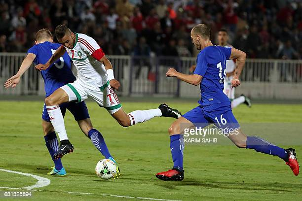 Morocco's forward Youssef EnNesyri challenges Finland's midfielder Sakari Mattila during a friendly football match between Morocco and Finland in...