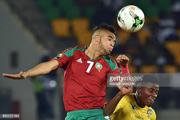 Morocco's forward Youssef EnNesyri heads the ball with Togo's midfielder Floyd Ayite during the 2017 Africa Cup of Nations group C football match...