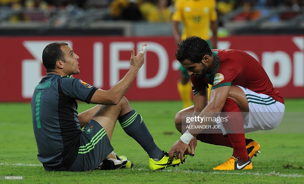 Morocco's goalkeeper Nadir Lamyaghri (L) gestures during the South Africa vs Morocco Africa Cup of Nations 2013 group A football match at Moses Mahiba Stadium in Durban on January 27, 2013 AFP PHOTO / ALEXANDER JOE