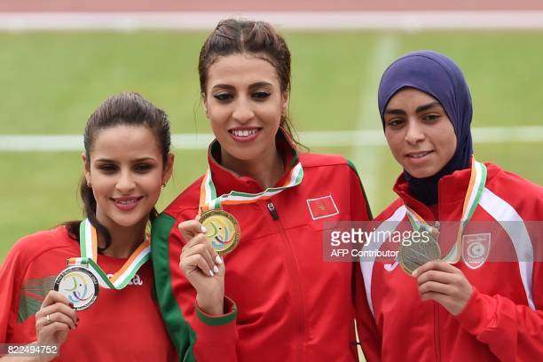 Morocco's gold medallist Fadwa Sidi Madane Morocco's silver medallist Oumaima Saoud and Tunisia's broze medallist Marwa Bouzayani pose on the podium...