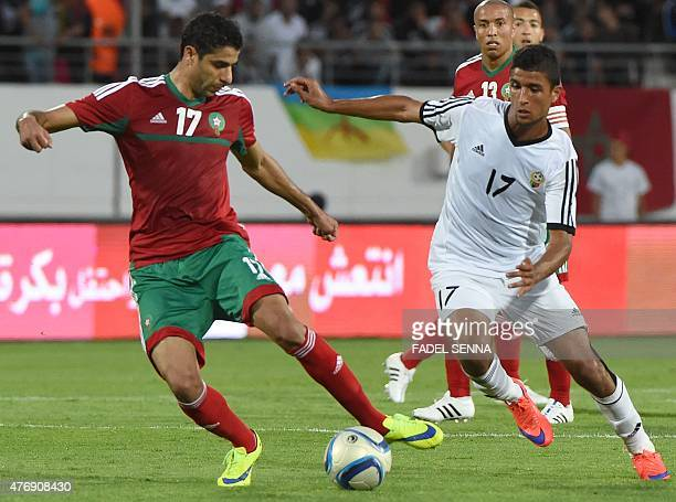 Morocco's Issam El Adoua vies for the ball with Libya's Rwid Abdulnaser Hamed during the 2017 Africa Cup of Nations qualifying football match against...