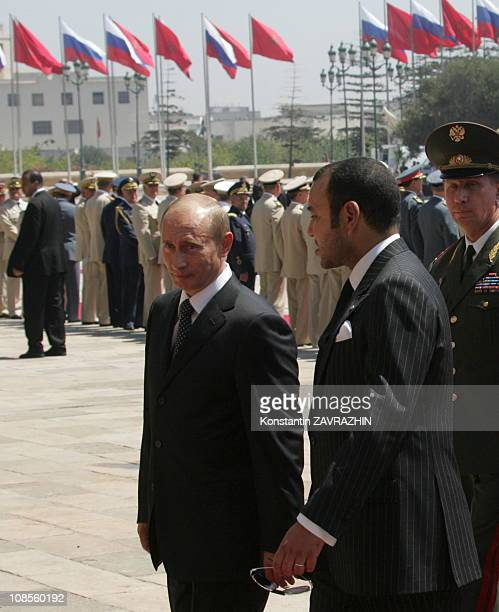 Morocco's King Mohammed VI escorts Russia's President Vladimir Putin during an honour guard ceremony at the King's palace in Casablanca Putin visited...