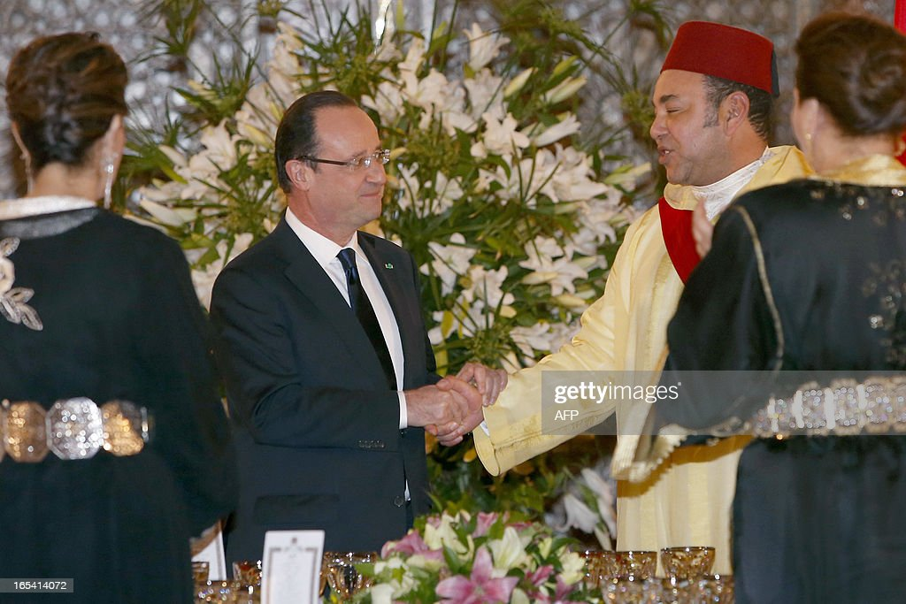 Morocco's King Mohammed VI (R) shakes hands with France's President Francois Hollande (L) during a State dinner at the king's Palace in Casablanca, on April 3, 2013. Hollande arrived in Morocco fresh from battling an explosive tax fraud scandal that risks overshadowing his landmark two-day visit to the former French colony.
