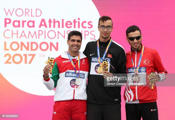 Morocco's Mahdi Afri Portugal's Luis Goncalves and Turkey's Oguzafter with their medals after the Men's 400m T12 Final during day five of the 2017...