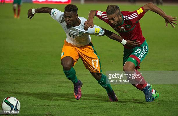 Morocco's midfielder Mehdi CarcelaGonzalez vies for the ball with Ivory Coast's defender Serge Aurier during the World Cup 2018 qualifier football...