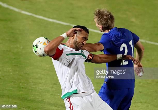 Morocco's midfielder Omar ElKaddouri heads the ball next to Finland's forward Eero Markkanen during a friendly football match between Morocco and...