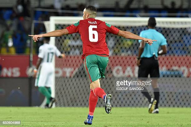 Morocco's midfielder Romain Saiss celebrates after his team scored a goal during the 2017 Africa Cup of Nations group C football match between...