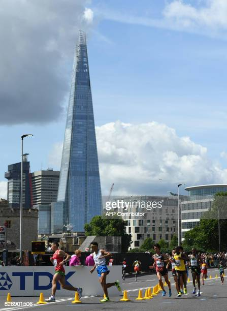 Morocco's Mohamed Reda El Aaraby and Italy's Daniele Meucci run with the Shard in the background during the men's marathon athletics event at the...