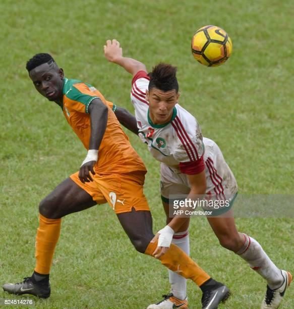 Morocco's player Achraf Dari vies Ivory Coast's Arnaud Ake Loba during the 8th Francophonie Games final football match between Ivory Coast and...