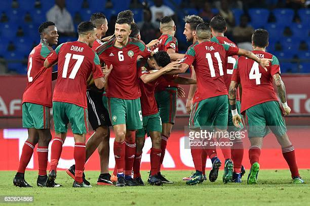 Morocco's players celebrate a goal during the 2017 Africa Cup of Nations group C football match between Morocco and Ivory Coast in Oyem on January 24...
