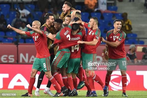 TOPSHOT Morocco's players celebrate after scoring a goal during the 2017 Africa Cup of Nations group C football match between Morocco and Ivory Coast...