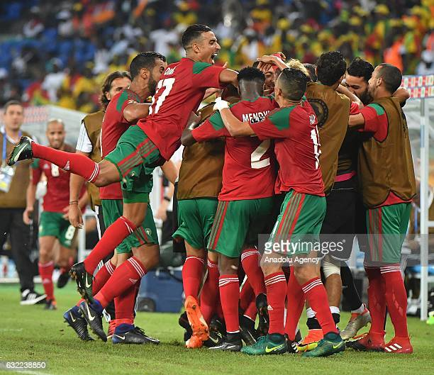 Morocco's players celebrate after scoring during the African Cup of Nations Group C soccer match between Morocco and Togo at the Stade d'Oyem on...