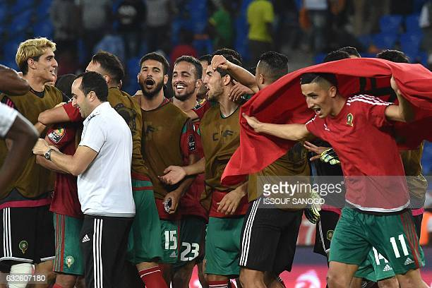 Morocco's players celebrate at the end of the 2017 Africa Cup of Nations group C football match between Morocco and Ivory Coast in Oyem on January 24...