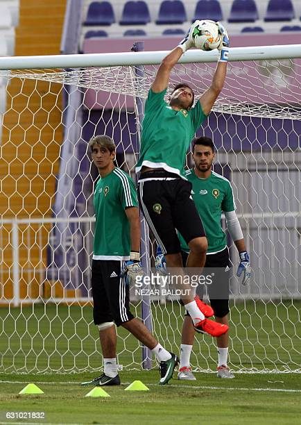 Morocco's players perform drills during a training session at the Sheikh Tahnoun Bin Mohammed Stadium in Al Ain on January 5 part of their...