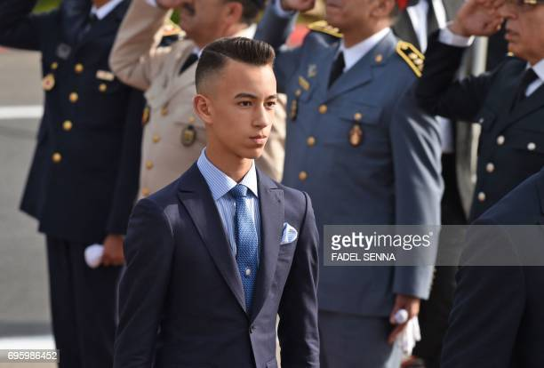Morocco's Prince Moulay Hassan walks next to his father King Mohammed VI upon the arrival of the French president in Rabat on June 14 2017 Emmanuel...