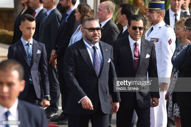 Morocco's Prince Moulay Hassan walks next to his father King Mohammed VI and the King's brother Prince Moulay Rachid as they welcome the French...