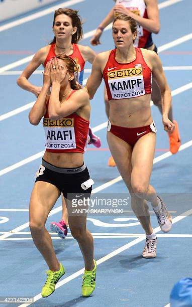 Morocco's Rababe Arafi reacts after winning followed by US Heather Kampf in the women 1500 heat 1 at the IAAF World Indoor Athletics Championships in...