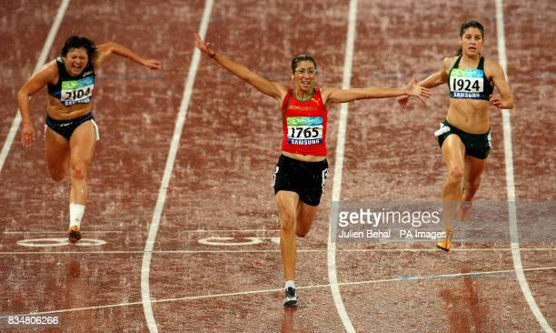 Morocco's Sanaa Benhama celebrates after winning the Womens 100M T13 Final ahead of Maryna Chyshko of Ukraine and Silver medal winner Lise Hayes of...
