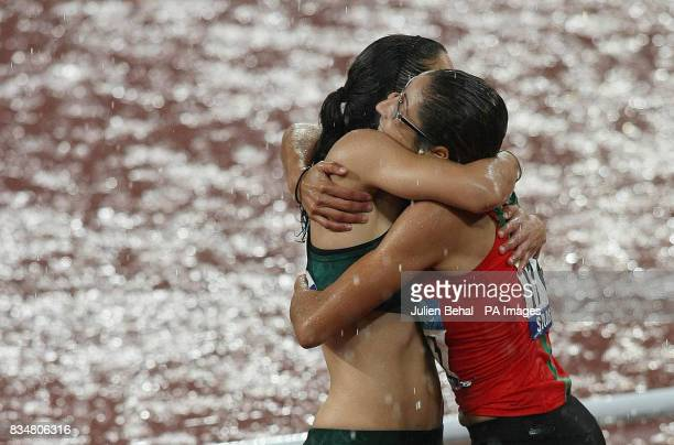 Morocco's Sanaa Benhama celebrates after winning the Womens 100M T13 Final with South Africa's Silver medal winner Lise Hayes in the National Stadium...