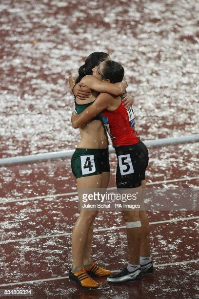 Morocco's Sanaa Benhama celebrates after winning the Women's 100M T13 with Silver medal winner Lise Hayes of South Africa in the National Stadium in...