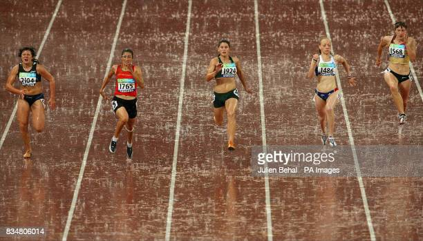 Morocco's Sanaa Benhama winning the Womens 100M T13 Final ahead of Silver medalist South Africa's Lise Hayes in the National Stadium in Beijing China