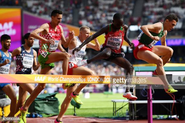 Morocco's Soufiane Elbakkali Kenya's Jairus Kipchoge Birech and Algeria's Bilal Tabti jump the hurdle as they compete in the heats of the men's 3000m...