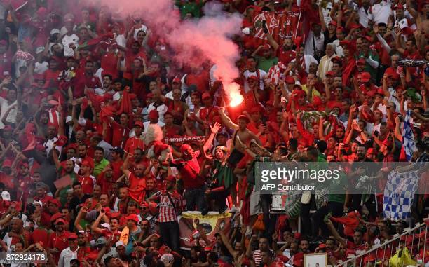 Morocco's team supporters celebrate at the Felix HouphouetBoigny stadium in Abidjan on November 11 at the end of the FIFA World Cup 2018 Africa Group...