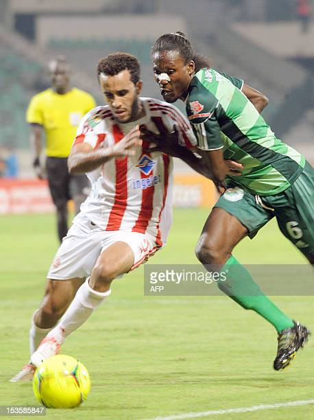 Morocco's Wydad Casablanca's Abdelghani Mouaoui vies with Congolese club AC Leopard's Magnokele Bissiki Davy Dimitri during a CAF Co0nfederation Cup...