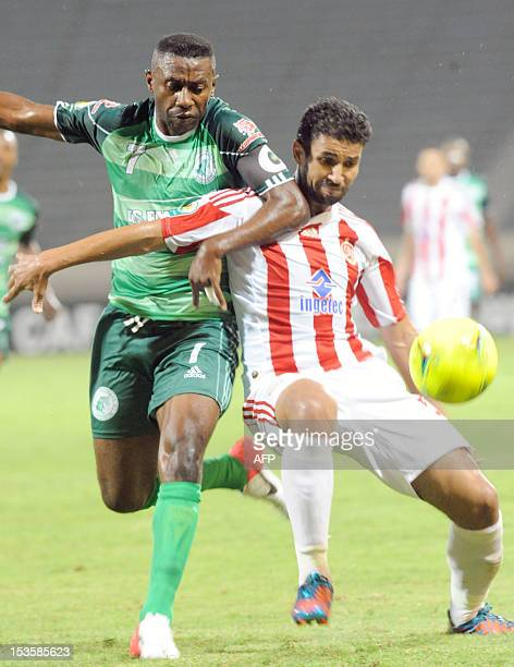 Morocco's Wydad Casablanca's Rabeh Youssef vies with Congolese club AC Leopard`Bhebey Ndey Rudy Guelord during a CAF Co0nfederation Cup Group B match...