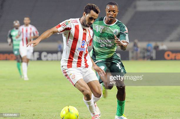 Morocco's Wydad Casablanca's Rabeh Youssef vies with Congolese club AC Leopard's Kombo Poungui Bienvenu during a CAF Co0nfederation Cup Group B match...