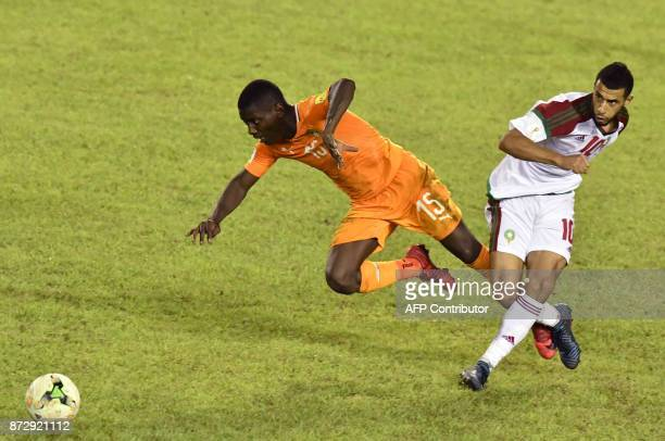 Morocco's Younes Belhanda vies with Ivory Coast's Max Gradel during the FIFA World Cup 2018 Africa Group C qualifying football match between Ivory...