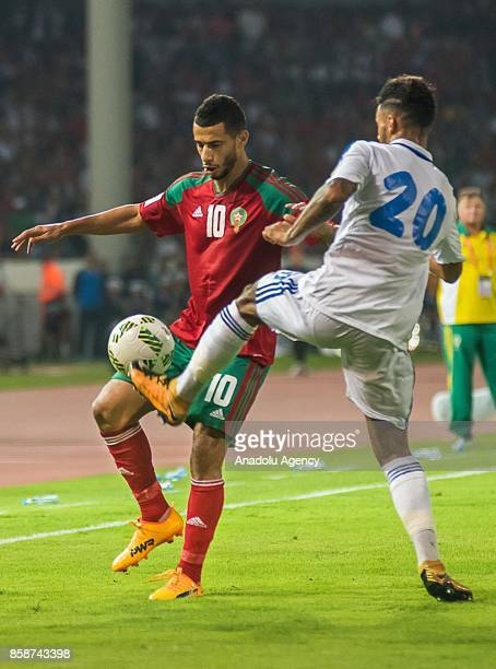 Morocco's Youness Belhanda vies for the ball with Gabon's Denis Bouanga during their FIFA World Cup 2018 Group C football match between Morocco and...