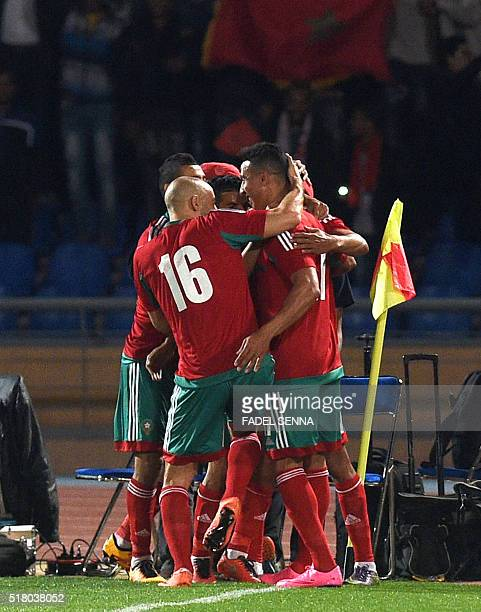 Morocco's Youssef ElArrabi celebrates with teammates after scoring a goal during their African Cup of Nations group F qualifying football match...