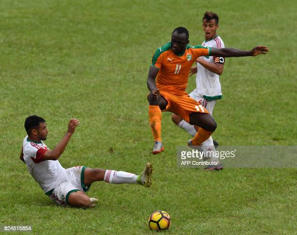 Morocco's Zakaria Nassik vies Ivory Coast's Thierry Marcial Kassi during the 8th Francophonie Games final football match between Ivory Coast and...