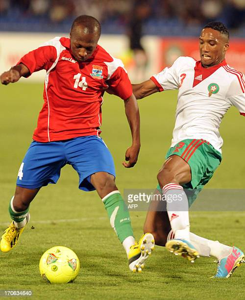 Morocco's Zakarya Bergdich and Sanna Nyassi of Gambia fight for the ball during the FIFA Brazil WC2014 qualifiers match on June 15 2013 in Marrakech...